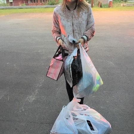 Girl with bag of donated clothes